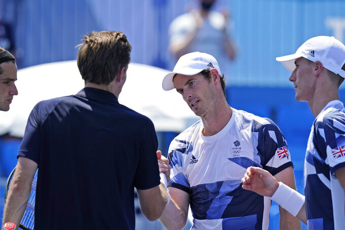 The British doubles team of Joe Salisbury, right, and Andy Murray, second from right, greet the French doubles team after defeating them during the first round of the tennis competition at the 2020 Summer Olympics, Saturday, July 24, 2021, in Tokyo, Japan. (AP Photo/Seth Wenig)
