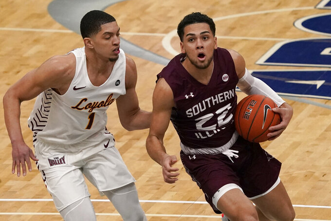 Southern Illinois' Steven Verplancken Jr. (22) heads to the basket past Loyola of Chicago's Lucas Williamson (1) during the first half of an NCAA college basketball game in the quarterfinal round of the Missouri Valley Conference men's tournament Friday, March 5, 2021, in St. Louis. (AP Photo/Jeff Roberson)