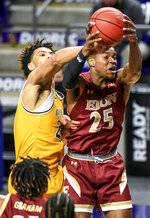 Drexel forward T.J. Bickerstaff (23) tries to grab a rebound against Elon guard Hunter Woods (25) during the first half of an NCAA college basketball game for the Colonial Athletic Association men's tournament championship in Harrisonburg, Va., Tuesday, March 9, 2021. (AP Photo/Daniel Lin)