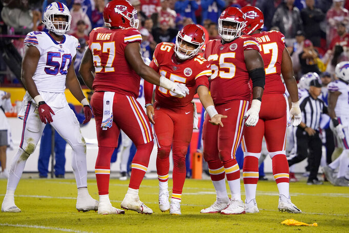 Kansas City Chiefs quarterback Patrick Mahomes (15) complains as a penalty flag is thrown during the second half of an NFL football game against the Buffalo Bills Sunday, Oct. 10, 2021, in Kansas City, Mo. (AP Photo/Ed Zurga)