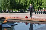Russian President Vladimir Putin stands during a minute of silence in memory of those killed during WWII as he takes part in a wreath laying ceremony at the Tomb of Unknown Soldier in Moscow, Russia, Tuesday, June 22, 2021, marking the 80th anniversary of the Nazi invasion of the Soviet Union. (Alexei Nikolsky, Sputnik, Kremlin Pool Photo via AP)