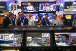 People view the CrystalBetting sports betting terminal at the IGT booth during the Global Gaming Expo, Wednesday, Oct. 10, 2018, in Las Vegas. (AP Photo/John Locher)