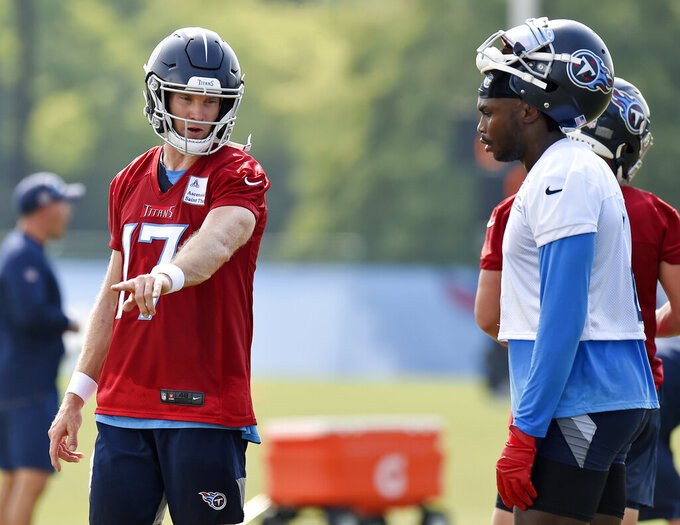 FILE - In this July 29, 2021, file photo, Tennessee Titans quarterback Ryan Tannehill (17) talks with wide receiver Julio Jones (2) during NFL football practice in Nashville, Tenn. Tannehill is the highest profile member of the Titans' latest COVID-19 outbreak. He returned to practice Monday and is busy working to finetune and reconnect with their biggest offseason addition Julio Jones before Sunday's opener with Arizona. (AP Photo/Mark Zaleski, File)