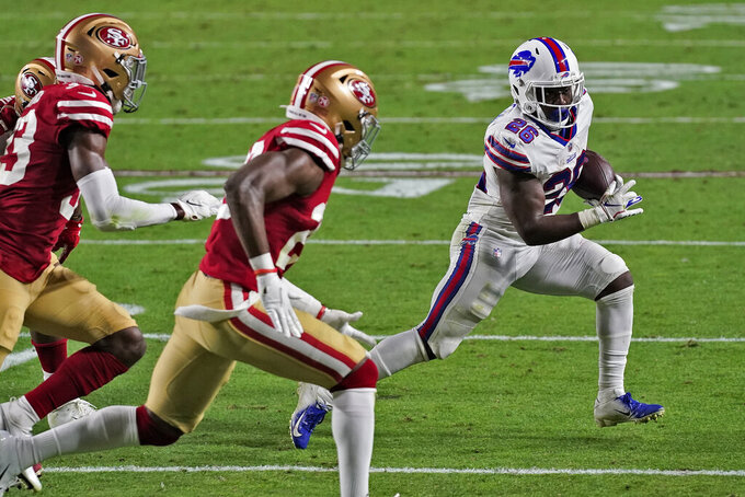 Buffalo Bills running back Devin Singletary (26) runs as San Francisco 49ers defensive back Tarvarius Moore, left, and cornerback Jason Verrett pursue during the first half of an NFL football game, Monday, Dec. 7, 2020, in Glendale, Ariz. (AP Photo/Ross D. Franklin)