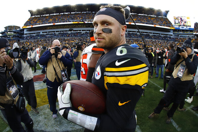Pittsburgh Steelers quarterback Devlin Hodges (6) stands on the field with a game ball after a 20-13 Steelers win over the Cleveland Browns in an NFL football game in Pittsburgh, Sunday, Dec. 1, 2019. (AP Photo/Gene J. Puskar)