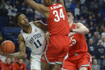Penn State's Lamar Stevens (11) drives the baseline and passes around Ohio State's Kaleb Wesson (34) and Kyle Young (25) during first half action of an NCAA college basketball game, Saturday, Jan. 18, 2020, in State College, Pa. (AP Photo/Gary M. Baranec)