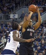 San Diego State forward Matt Mitchell (11) shoots over Nevada forward Jordan Caroline (24) in the first half of an NCAA college basketball game in Reno, Nev., Saturday, March 9, 2019. (AP Photo/Tom R. Smedes)