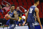 Nevada forward Jordan Caroline, left, laughs with teammate Trey Porter during practice at the NCAA men's college basketball tournament, Wednesday, March 20, 2019, in Des Moines, Iowa. Nevada plays Florida on Thursday. (AP Photo/Charlie Neibergall)