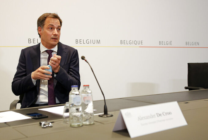 Belgium's Prime Minister Alexander De Croo prepares to speak during a media conference after a Belgian government meeting to discuss coronavirus, COVID-19, measures in Brussels, Tuesday, May 11, 2021. (AP Photo/Olivier Matthys, Pool)