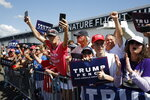Supporters cheer as President Donald Trump speaks during a campaign event with Florida Sheriffs in Tampa, Fla., Friday, July 31, 2020. (AP Photo/Patrick Semansky)
