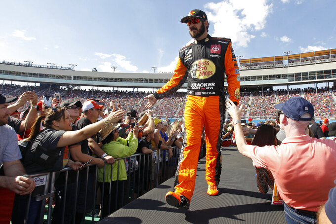 Martin Truex Jr. greets fans during driver introductions prior to the NASCAR Cup Series auto race at ISM Raceway, Sunday, Nov. 10, 2019, in Avondale, Ariz. (AP Photo/Ralph Freso)