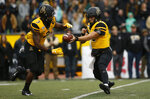 Appalachian State quarterback Zac Thomas (12) hands off to running back Darrynton Evans (3) during the first half of an NCAA college football game against the Louisiana Monroe Saturday, Oct. 19, 2019, in Boone, NC. (AP Photo/Brian Blanco)