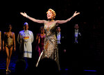 FILE - In this April 10, 2014 file photo, actor Marin Mazzie on stage during the curtain call for the opening night of