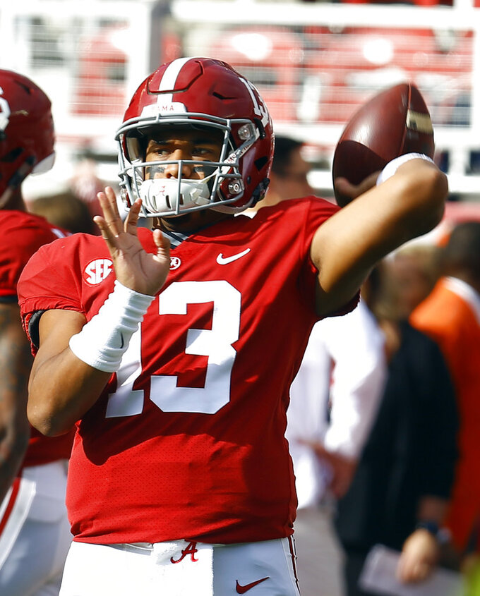 Alabama quarterback Tua Tagovailoa (13) warms up before an NCAA college football game against Auburn, Saturday, Nov. 24, 2018, in Tuscaloosa, Ala. (AP Photo/Butch Dill)