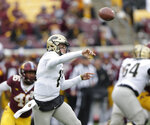 Purdue quarterback David Blough throws (4) against Minnesota in the first quarter against Minnesota in a NCAA college football game Saturday, Nov. 10, 2018, in Minneapolis. (AP Photo/Andy Clayton-King)