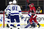 Carolina Hurricanes right wing Jesper Fast (71), of Sweden, reacts following a goal against Tampa Bay Lightning goaltender Andrei Vasilevskiy (88), of Russia, during the first period of an NHL hockey game in Raleigh, N.C., Monday, Feb. 22, 2021. Tampa Bay Lightning center Steven Stamkos (91) looks on. (AP Photo/Gerry Broome)