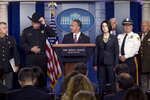 Immigration and Customs Enforcement Director Matt Albence, center, accompanied by sheriffs from around the country including Tarrant County, Texas Sheriff Bill Waybourn, second from left, speaks in the Briefing Room at the White House in Washington, Thursday, Oct. 10, 2019. (AP Photo/Andrew Harnik)
