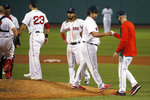 Boston Red Sox relief pitcher Robert Stock hands the ball over to manager Ron Roenicke as leaves the baseball game against the Atlanta Braves during the sixth inning Tuesday, Sept. 1, 2020, in Boston. (AP Photo/Mary Schwalm)