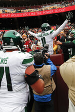 New York Jets wide receiver Robby Anderson (11) celebrates his touchdown against Washington Redskins in the first half of an NFL football game, Sunday, Nov. 17, 2019, in Landover, Md. (AP Photo/Alex Brandon)