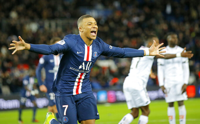 FILE - In this Feb.29, 2020 file photo, PSG's Kylian Mbappe celebrates after scoring his side's fourth goal during the French League One soccer match between Paris-Saint-Germain and Dijon, at the Parc des Princes stadium in Paris. Paris Saint-Germain has been declared French league champion after the soccer season ended early because of the coronavirus pandemic. (AP Photo/Michel Euler, File)