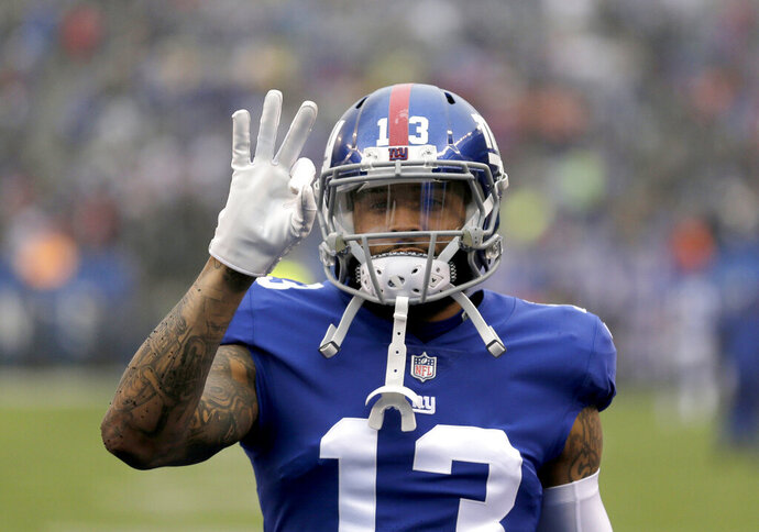 FILE - In this Dec. 2, 2018, file photo, New York Giants wide receiver Odell Beckham Jr. gestures prior to the team's NFL football game against the Chicago Bears in East Rutherford, N.J. Two people familiar with the blockbuster trade say the Cleveland Browns have agreed to acquire Beckham from the Giants. (AP Photo/Seth Wenig, File)