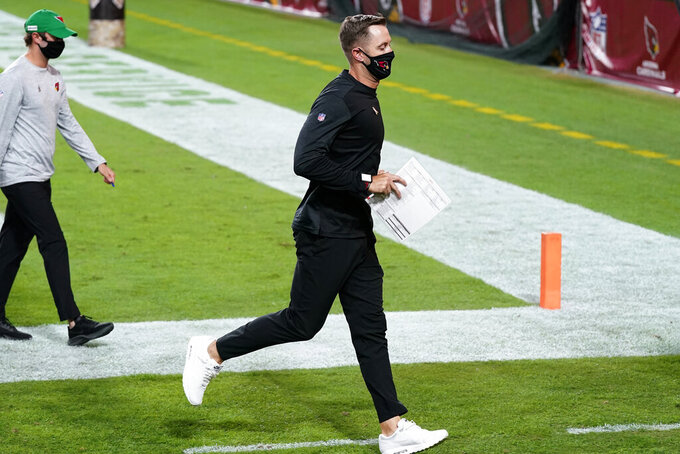 Arizona Cardinals head coach Kliff Kingsbury leaves the field after an NFL football game against the Miami Dolphins, Sunday, Nov. 8, 2020, in Glendale, Ariz. The Dolphins won 34-31. (AP Photo/Ross D. Franklin)