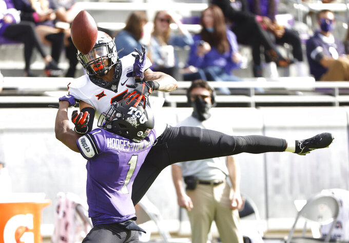 TCU cornerback Tre'vius Hodges-Tomlinson breaks up a pass intended for Oklahoma State wide receiver Tylan Wallace (2) during the first half of an NCAA college football game Saturday, Dec. 5, 2020, in Fort Worth, Texas. (AP Photo/Ron Jenkins)