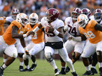 Tennessee defensive lineman Kyle Phillips (5) and Tennessee defensive lineman Alexis Johnson Jr. (98) go after Alabama quarterback Tua Tagovailoa (13) during the first half of an NCAA college football game, Saturday, Oct. 20, 2018, in Knoxville, Tenn. (Joy Kimbrough /The Daily Times via AP)