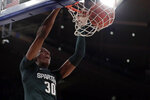 Michigan State forward Marcus Bingham Jr. (30) dunks during the first half of the team's NCAA college basketball game against Kentucky on Tuesday, Nov. 5, 2019, in New York. (AP Photo/Adam Hunger)
