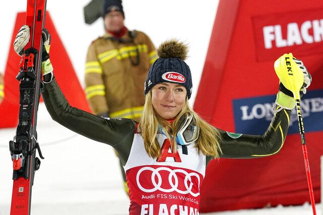United States' Mikaela Shiffrin celebrates after taking third place an alpine ski, women's World Cup slalom in Flachau, Austria, Tuesday, Jan. 14, 2020. (AP Photo/Giovanni Auletta)