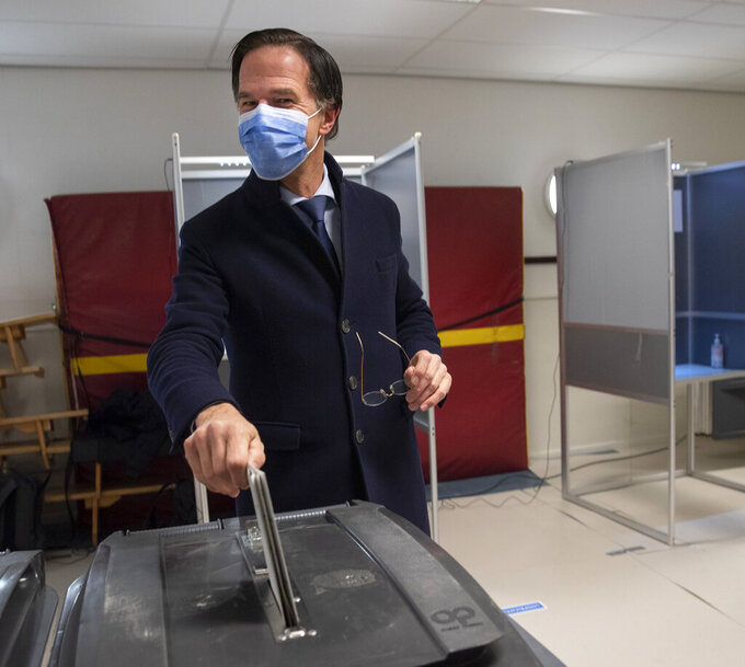 Dutch caretaker Prime Minster Mark Rutte casts his vote in a general election in The Hague, Wednesday, March 17, 2021. Polling stations have opened opened across the Netherlands from Monday in a general election that has been spread over three days to allow people to vote safely during the coronavirus pandemic. (AP Photo/Peter Dejong, Pool)