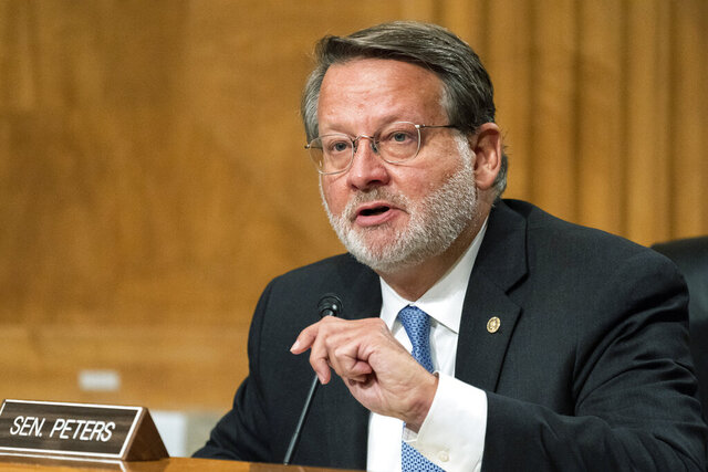 FILE - In this Sept. 6, 2020 file photo, Senate Homeland Security and Governmental Affairs Committee ranking member Sen. Gary Peters, D-Mich. speaks on Capitol Hill, in Washington. Sen. Peters and Republican challenger John James have staked out differing stances on the fight over President Donald Trump's pending Supreme Court pick.(AP Photo/Manuel Balce Ceneta File)