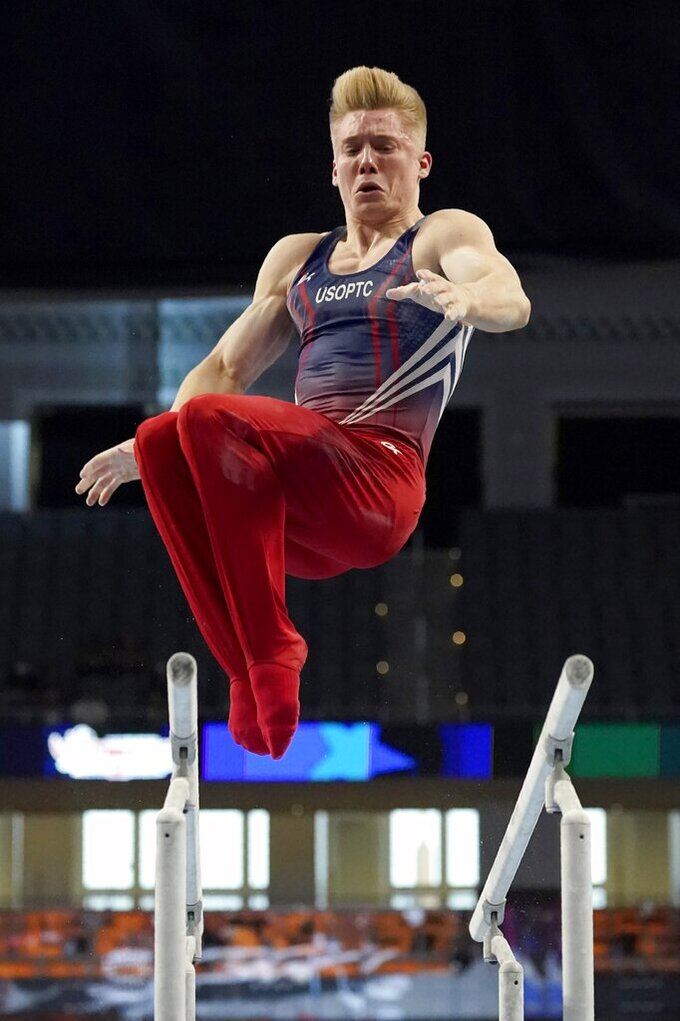 Shane Wiskus competes on the parallel bars during the U.S. Gymnastics Championships, Thursday, June 3, 2021, in Fort Worth, Texas. (AP Photo/Tony Gutierrez)