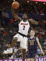Louisville's Darius Perry (2) drives past Notre Dame's Dane Goodwin (23) during the first half of an NCAA college basketball game in the Atlantic Coast Conference tournament in Charlotte, N.C., Wednesday, March 13, 2019. (AP Photo/Nell Redmond)