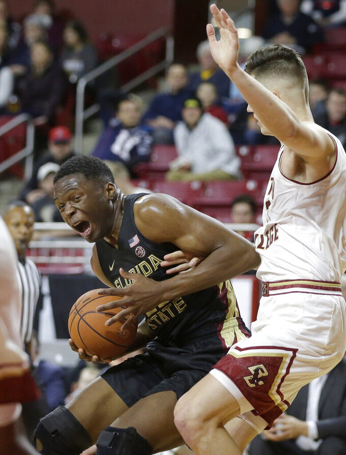 Florida State's Mfiondu Kabengele, left, looks for an opening around Boston College's Luka Kraljevic, right, in the first half of an NCAA college basketball game, Sunday, Jan. 20, 2019, in Boston. (AP Photo/Steven Senne)