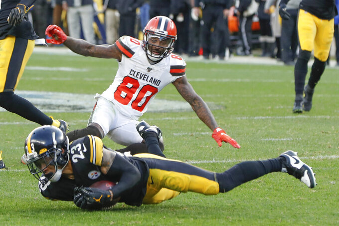 Pittsburgh Steelers cornerback Joe Haden (23) intercepts a pass intended for Cleveland Browns wide receiver Jarvis Landry (80) during the second half of an NFL football game, Sunday, Dec. 1, 2019, in Pittsburgh. The Steelers won 20-13. (AP Photo/Don Wright)