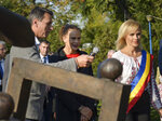 FILE - In this Wednesday, Oct. 4, 2017 file photo, Princess Stephanie of Monaco, center, and the Mayor of Bucharest, Gabriela Firea, right, attend the unveiling of a monument that celebrates circus arts dedicated to her late father, Prince Rainier III of Monaco, in Bucharest, Romania. Romania is gripped by a political soap opera featuring French Open tennis champion Simona Halep, the world famous soprano Angela Gheorghiu and the mayor of Bucharest Gabriela Firea. (AP Photo/Andreea Alexandru, File)