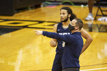 Oral Roberts coach Paul Mills, front, talks with Kareem Thompson during the first half of the team's NCAA college basketball game against Missouri on Wednesday, Nov. 25, 2020, in Columbia, Mo. (AP Photo/L.G. Patterson)