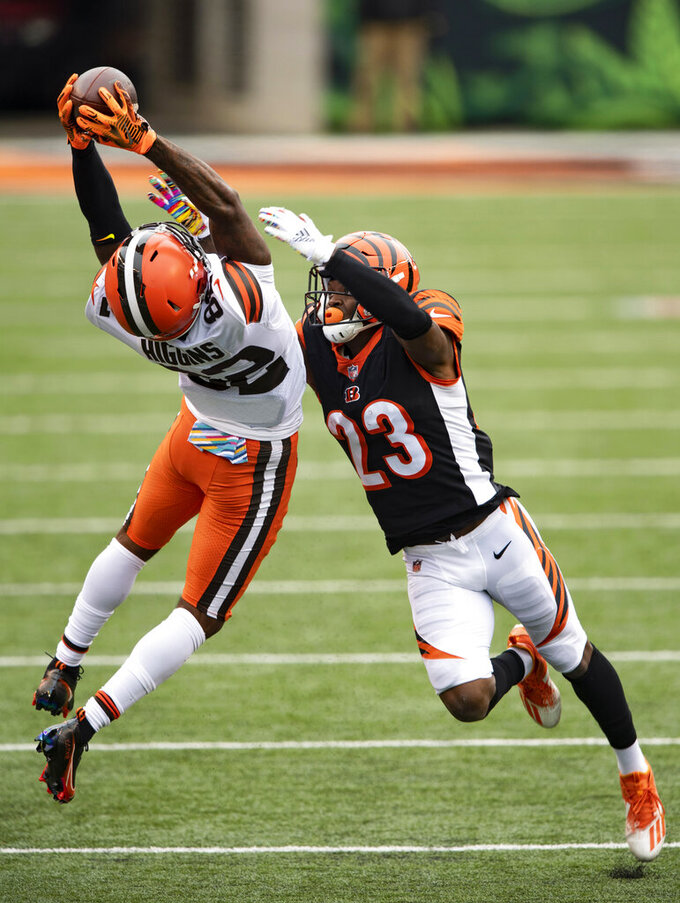 FILE - In this Sunday, Oct. 25, 2020, file photo, Cleveland Browns wide receiver Rashard Higgins (82) reaches for a pass as Cincinnati Bengals cornerback Darius Phillips (23) defends during an NFL football game in Cincinnati. The sure-handed wide receiver came in last week and made several clutch catches for the Browns after Odell Beckham Jr. got hurt. (AP Photo/Emilee Chinn, File)