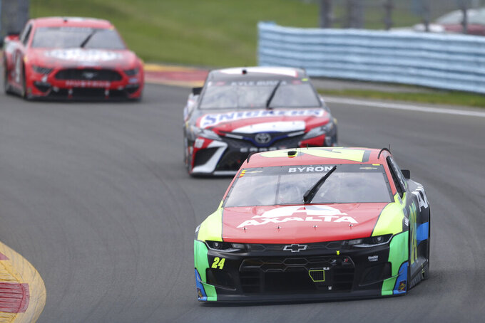 William Byron (front) leads Kyle Busch as they turn to the Esses during a NASCAR Cup Series auto race in Watkins Glen, N.Y., on Sunday, Aug. 8, 2021. (AP Photo/Joshua Bessex)