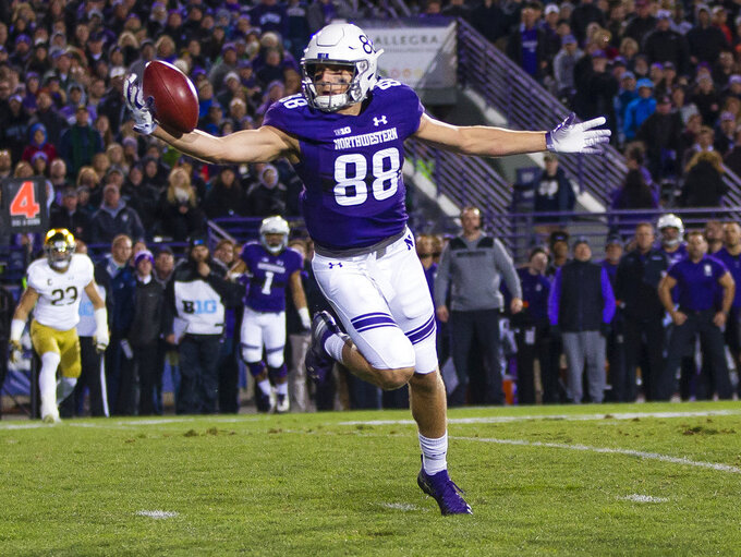 Northwestern's Bennett Skowronek (88) makes a one-handed catch during the team's NCAA college football game against Notre Dame on Saturday, Nov. 3, 2018, in Evanston, Ill. (Michael Caterina/South Bend Tribune via AP)