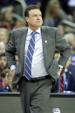 Kansas head coach Bill Self looks to the clock during the first half of an NCAA college basketball game against West Virginia in the semifinals of the Big 12 conference tournament in Kansas City, Mo., Friday, March 15, 2019. (AP Photo/Orlin Wagner)