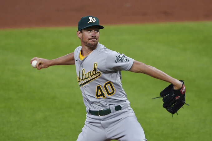 Oakland Athletics pitcher Chris Bassitt throws to a Baltimore Orioles batter during the first inning of a baseball game Saturday, April 24, 2021, in Baltimore. (AP Photo/Gail Burton)