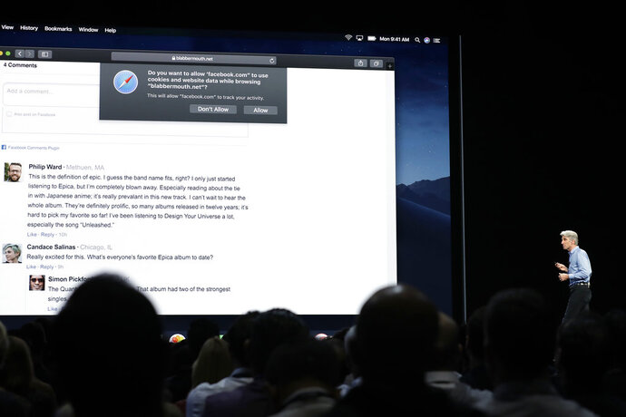 In this June 4, 2018, photo Craig Federighi, Apple's senior vice president of Software Engineering, speaks during an announcement of new products at the Apple Worldwide Developers Conference in San Jose, Calif.  Facebook and other companies routinely track your online surfing habits to better target ads at you. Two web browsers now want to help you fight back in what's becoming an escalating privacy arms race. New protections in Apple's Safari and Mozilla's Firefox browsers aim to prevent companies from turning