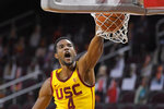 FILE - In this Feb. 17, 2021, file photo, Southern California forward Evan Mobley dunks during the second half of an NCAA college basketball game against Arizona State in Los Angeles. Mobley is The AP Pac-12 newcomer of the year and a member of the All-Pac 12 first team, announced Tuesday, March 9, 2021. (AP Photo/Mark J. Terrill, File)