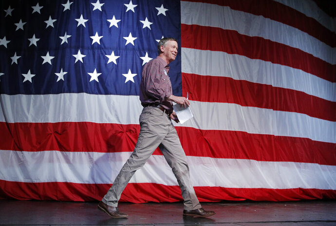 Democratic president candidate and former Colorado Gov. John Hickenlooper walks on stage before speaking at the Iowa Democratic Wing Ding at the Surf Ballroom, Friday, Aug. 9, 2019, in Clear Lake, Iowa. (AP Photo/John Locher)