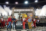 Kyle Larson, center right, is presented with his trophy in victory lane after winning a NASCAR Cup Series auto race at Bristol Motor Speedway Saturday, Sept. 18, 2021, in Bristol, Tenn. (AP Photo/Mark Humphrey)