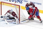 Colorado Avalanche goaltender Pavel Francouz stops Montreal Canadiens' Artturi Lehnonen (62) as Avalanche's Ryan Graves defends during the second period of an NHL hockey game Thursday, Dec. 5, 2019, in Montreal. (Graham Hughes/The Canadian Press via AP)