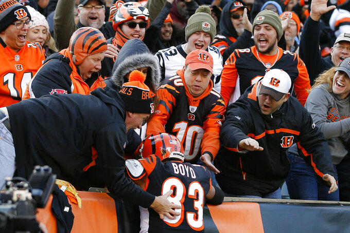 Cincinnati Bengals wide receiver Tyler Boyd (83) celebrates his touchdown during the first half an NFL football game against the Pittsburgh Steelers, Sunday, Nov. 24, 2019, in Cincinnati. (AP Photo/Frank Victores)