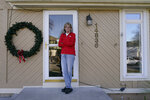 Keli Paaske stands outside her home in Olathe, Kan. Friday, Dec. 4, 2020. Paaske was laid off in August from a company supplying fire doors to hospitals after being furloughed for five months and has struggled to find a new job. (AP Photo/Charlie Riedel2
